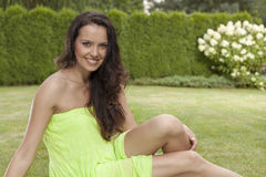 Portrait of beautiful young woman in sundress relaxing in park Stock Image