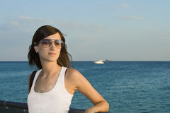 Portrait of a beautiful young woman in sunglasses Stock Photos