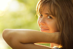 Portrait of a beautiful young woman in sunlight Royalty Free Stock Images