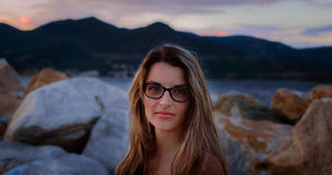 Portrait. Of a beautiful young woman at sunset Royalty Free Stock Images