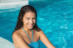 Portrait of a beautiful young woman by swimming pool Stock Image