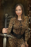 Portrait of a beautiful young woman  with sword in hand Stock Photo