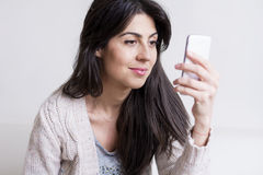 Portrait of beautiful young woman talking on the phone Stock Images