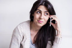 Portrait of beautiful young woman talking on the phone Stock Image
