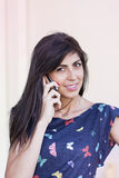 Portrait of beautiful young woman talking on the phone Royalty Free Stock Images