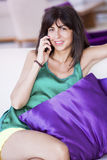 Portrait of beautiful young woman talking on the phone in a hotel room Stock Photos
