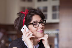 Portrait of beautiful young woman talking on the phone Royalty Free Stock Image