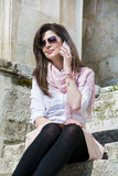 Portrait of beautiful young woman talking on the phone outdoor Royalty Free Stock Photography