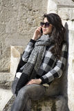 Portrait of beautiful young woman talking on the phone outdoor Stock Image