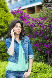 Portrait of beautiful young woman talking on the phone outdoor Royalty Free Stock Photos