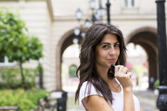 Portrait of beautiful young woman talking on the phone outdoor Royalty Free Stock Photo