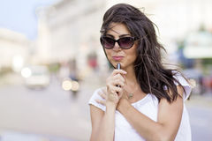 Portrait of beautiful young woman talking on the phone outdoor Stock Photos