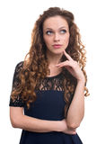Portrait of a beautiful young woman thinking Stock Photo
