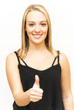 Portrait of Beautiful Young Woman with the thumb upwards over Stock Photos
