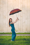 Portrait of beautiful young woman with umbrella. Portrait of beautiful red-haired young woman with umbrella Royalty Free Stock Image