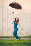 Portrait of beautiful young woman with umbrella. Portrait of beautiful red-haired young woman with umbrella Royalty Free Stock Photography