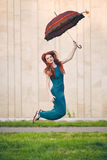Portrait of beautiful young woman with umbrella. Portrait of beautiful red-haired young woman with umbrella Stock Photos
