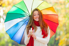 Portrait of beautiful young woman with umbrella on the wonderful Royalty Free Stock Photography