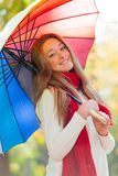 Portrait of beautiful young woman with umbrella on the wonderful Stock Photography