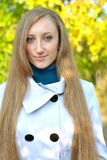 Portrait of beautiful young woman walking outdoors Royalty Free Stock Photos