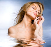 Portrait beautiful young woman in the water. Reflected in the water Royalty Free Stock Photos
