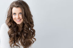Portrait of a beautiful young woman with wavy hair. Royalty Free Stock Photo