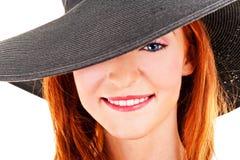 Portrait of beautiful young woman wearing black hat Stock Photo