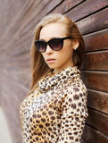 Portrait of beautiful young woman wearing a leopard dress Stock Photography