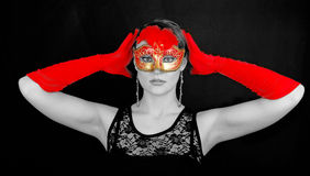 Portrait of beautiful young woman wearing red mask Royalty Free Stock Image