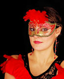 Portrait of beautiful young woman wearing red mask Stock Images