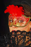Portrait of beautiful young woman wearing red mask stock photo