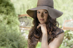 Portrait of beautiful young woman wearing sunhat in park Royalty Free Stock Images