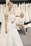 Portrait of a beautiful young woman in wedding dress with mother sitting background Stock Image