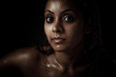 Portrait of beautiful young woman with wet face Stock Photos