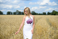 Portrait of beautiful young woman in white dress, wheat field Stock Photo