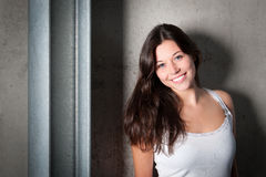 Portrait of a beautiful young woman in white top Royalty Free Stock Photography