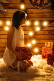 Portrait of a beautiful young woman who holds a gift for new year and Christmas royalty free stock photos