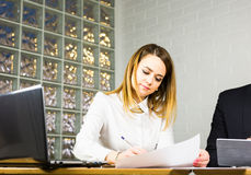 Portrait of beautiful young woman working in her office. Royalty Free Stock Image