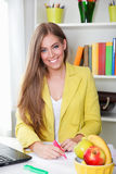 Portrait of a beautiful young woman working Stock Images