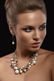 Portrait of beautiful young women. Black background. Studio light Stock Images