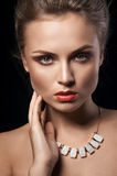 Portrait of beautiful young women. Black background. Studio light Stock Image