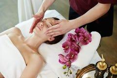 Woman Enjoying Facial Massage in SPA Stock Image