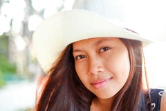 Portrait of a beautifull asian girl with white hat on summer vacation on the beach Stock Photo