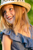 Portrait of beautifull girl. Portrait of smiling beautifull girl in the straw hat. Sunny summer. Sunlight royalty free stock photo
