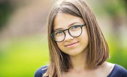 Portrait of a beautifull smilling teenage girl with glasses.  Royalty Free Stock Photography