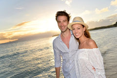 Portrait of beautiul couple at sunset by the sea Royalty Free Stock Images