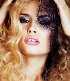 Portrait of beauty blond young woman through black lace close up sensual seduction. Concept Royalty Free Stock Image