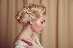 Portrait of beauty bride in white dress with classic hairstyle. stock image