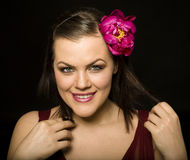 Portrait of beauty brunette woman with flower in her hair. Close up Royalty Free Stock Images