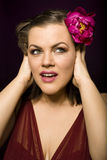 Portrait of beauty brunette woman with flower in her hair. Close up Stock Photography